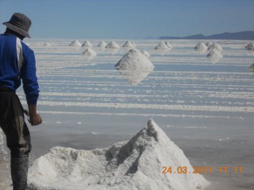 Men working on the salt flats, Uyuni, Bolivia.