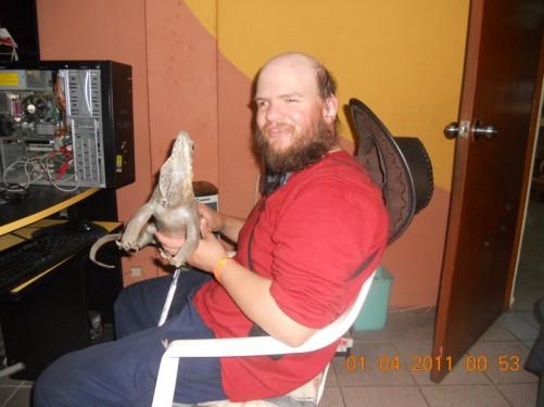 Tony in Paul's apartment holding an iguana.
