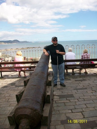 Tony stood by canon Lyme Regis.