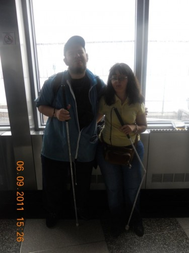 Tony and Tatiana inside the glass building of the observation deck.