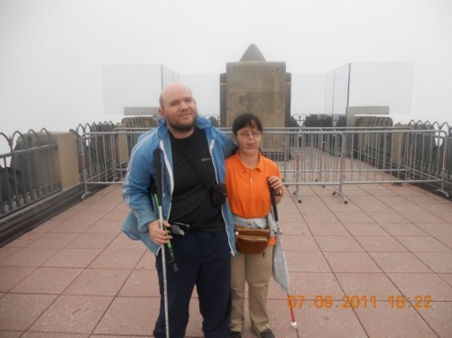 Tony and Tatiana on the GE Building's observation deck. The view is completely obscured by cloud.