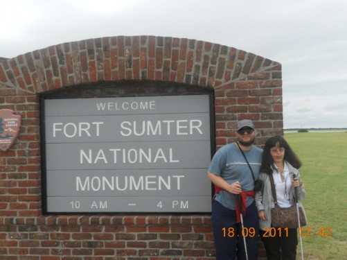 Tony, Tatiana by Fort Sumter sign.