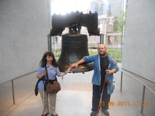 Tony, Tatiana touching the historic Liberty Bell.