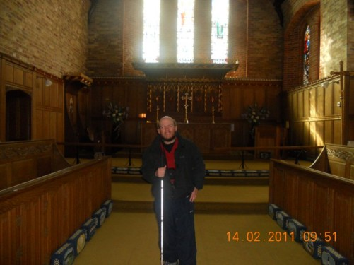 Tony stood in front of the altar inside Christ Church Cathedral.