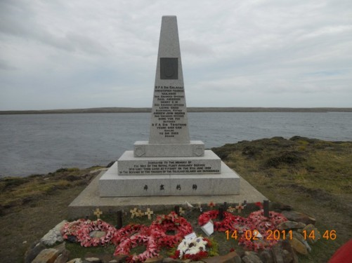 Memorial dedicated to members of the Royal Fleet Auxiliary Service who lost their lives in the disaster at Fitzroy/Bluff Cove on 8th June 1982. Located by the sea at Fitzroy, about a half hour drive from Stanley.