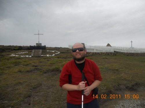 Tony with more memorials, some containing metal crosses.