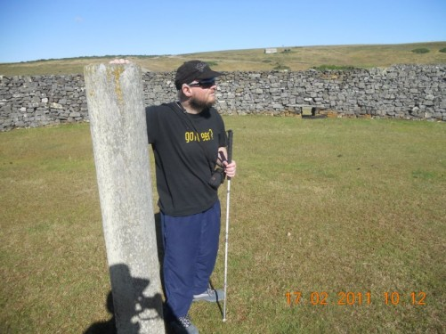 Tony by a historical stone corral, the wooden post was used to tie horses.