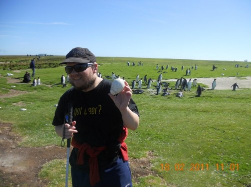 Tony holding an egg, King Penguins in the background.