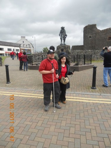 Tony, Tatiana in front of a statue of King William III (William of Orange) outside Carrickfergus Castle.