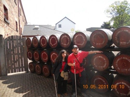 Tony and Tatiana in front of a stack of whisky barrels outside Old Bushmills Distillery in the town of Bushmills.