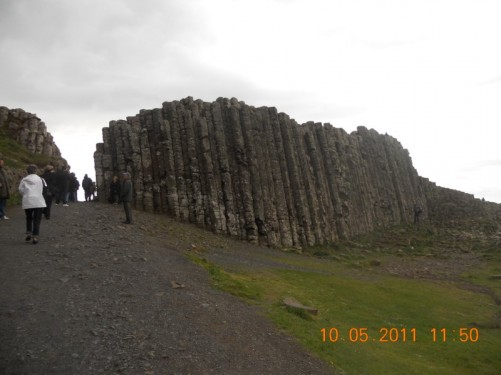 Causeway rock wall composed of solidified lava containing the distinctive basalt columns.