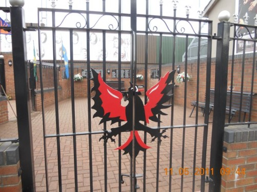 Black iron gates with black and red iron phoenix, entrance gate of the memorial.