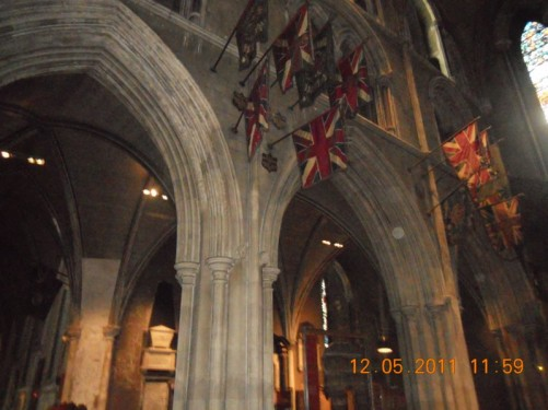 Flags inside the cathedral, including several Union Jacks.