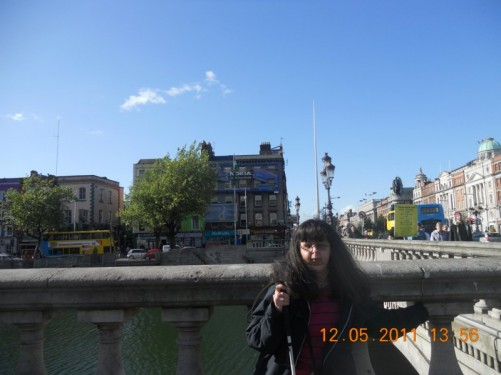 Tatiana and a view of the O'Connell Bridge over the River Liffey from the south end of the bridge.