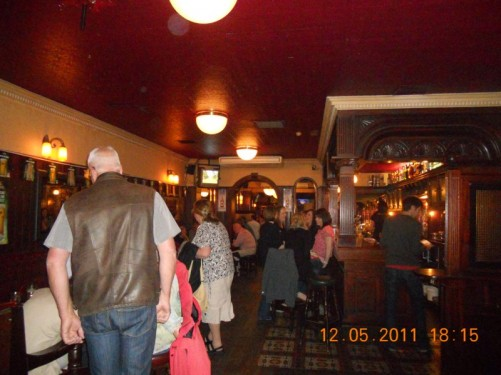 Inside a large Irish pub during the evening.