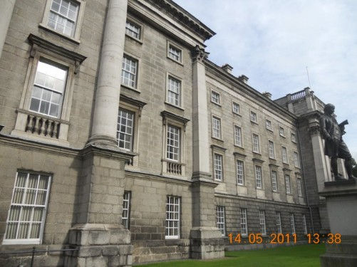 A large building seen from the gateway, part of Trinity College.