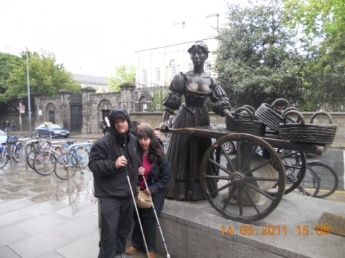 Oversized bronze statue of Molly Malone pushing her flower cart, located at the bottom end of Grafton street by the junction with Nassau Street.