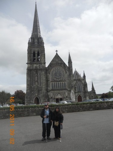 Tony, Tatiana in front of St Colman's Cathedral, town of Cobh, County Cork.