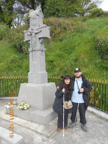 Tony, Tatiana by the stone cross. Memorial to Michael Collins, situated at Beal na Blath.
