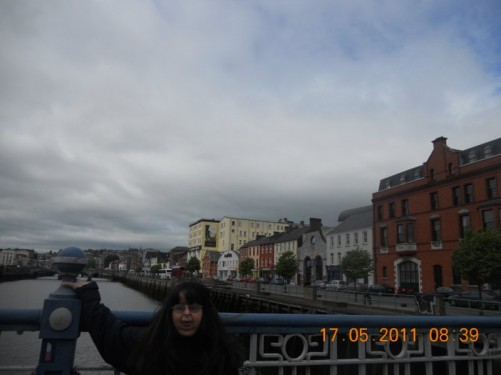 Tatiana standing on a bridge over the River Lee, Cork City.
