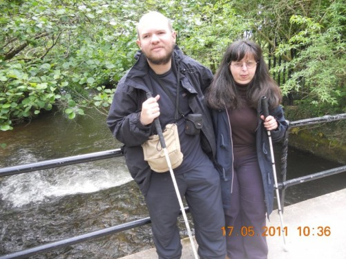 Tony, Tatiana standing on a bridge over a lake in the grounds of Blarney Castle, part of the estate.