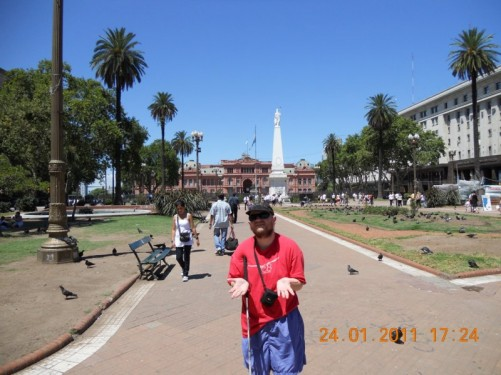 Tony in Plaza de Mayo (May Square), with the famous Casa Rosada (pink house), home of Argentina's President, in the background - the Pyramid de Mayo Statue, located in the square's centre, is also visible.