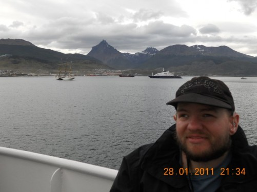 Tony on the deck of the MV Ushuaia. View of the Martial Mountains away in the distance.