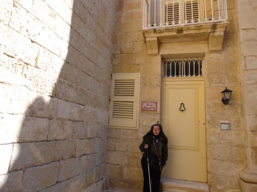 Tatiana outside the doorway to a house in Mdina.
