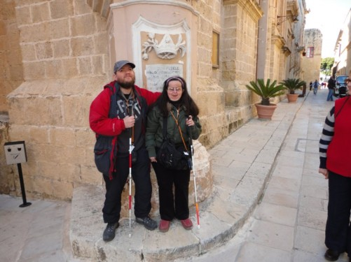 Tony and Tatiana in front of a statue of Our Lady of Mount Carmel (only the base of the statue is visible). Outside the Carmelite Church and Priory.