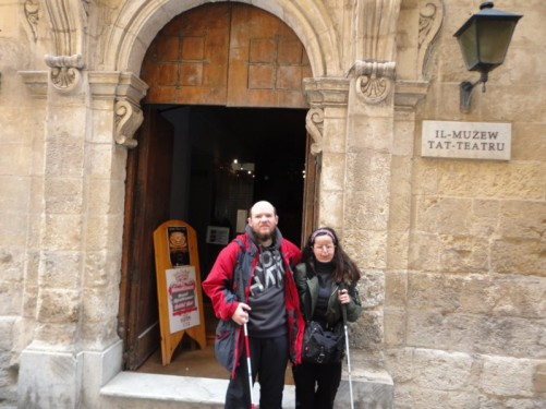 Tony and Tatiana outside the Manoel Theatre entrance. The theatre is at 115 Old Theatre Street between Old Mint Street and Old Bakery Street.