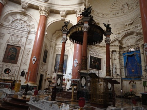 The altar of the Sanctuary Basilica of Our Lady of Mount Carmel. The original church on this site dated from 1570, but it was destroyed by World War Two bombing and was later completely rebuilt. The new church has a 42-metre high elliptical dome.