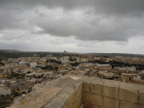 View across Victoria from the Citadel. Away in the far distance, the smaller town of Xewkija can also be seen with its massive Rotunda church built between 1951 and 1971.