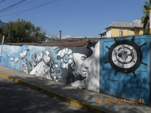 A wall in a side street decorated with graffiti. Located in Barrio Brasil, a bohemian neighbourhood and university area in downtown Santiago.