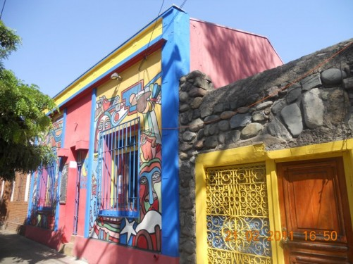 Exterior of a building painted with colourful graffiti.