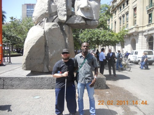 Tony with a Colombian guy he met in the cathedral. Behind is an unusual statue dedicated to Chile's indigenous peoples.