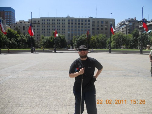 Tony in Plaza de la Constitucion (Constitution Square). Lots of Chilean flags.