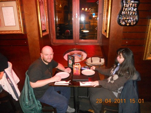 Tony and Tatiana sitting at a table in the Hard Rock Cafe, in Athens.