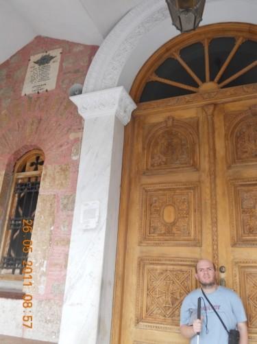 Tony in front of the same doorway.