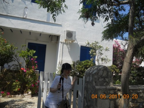 Tatiana outside the gate to the Young Inn, Naoussa.