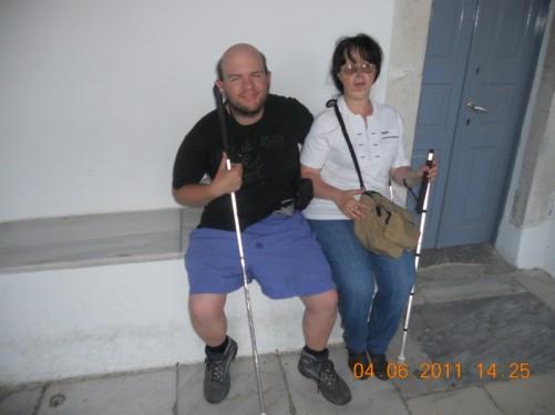 Tony and Tatiana sitting outside the church.