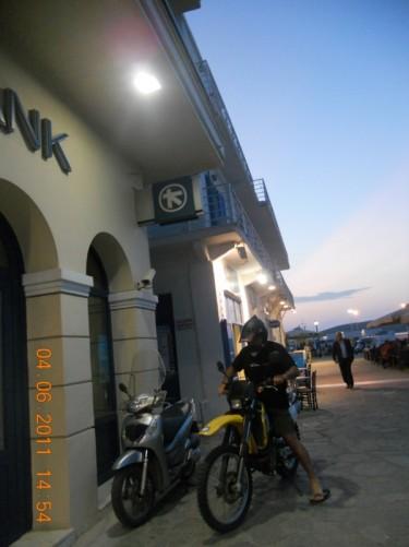 Near the harbour. A row of shops, cafés and restaurants.