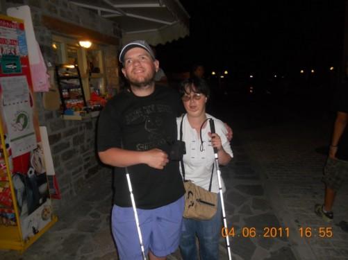 Tony and Tatiana in the street. Late evening.