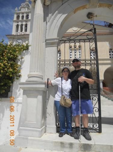 Tony and Tatiana at a gateway leading up to Agia Triada church.