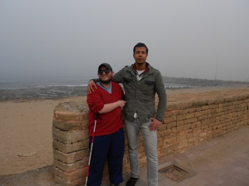 Tony with a local man. Overlooking Rabat Beach.