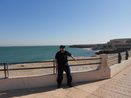 Tony leaning on railings above Dakhla Beach near the town centre.