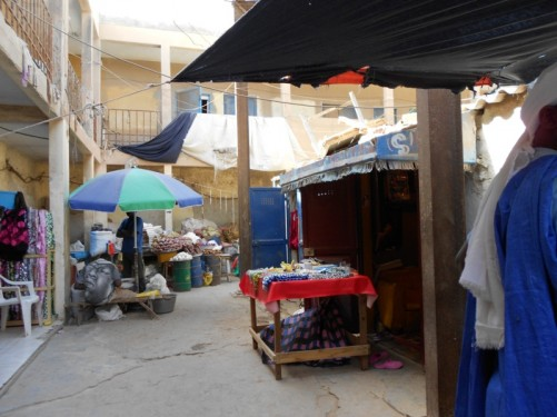 More stalls - selling textiles and foodstuffs.