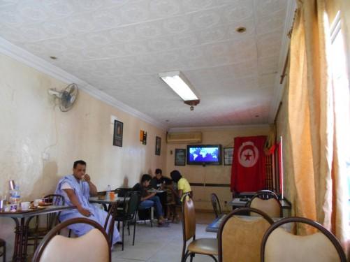 Inside a café. A few locals having drinks and snacks.