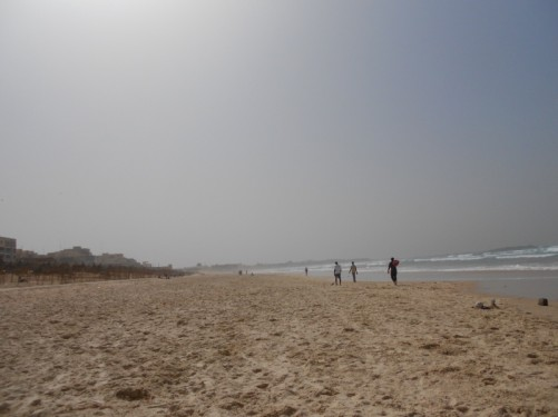 An excellent view along Yoff Beach off into the hazy distance.