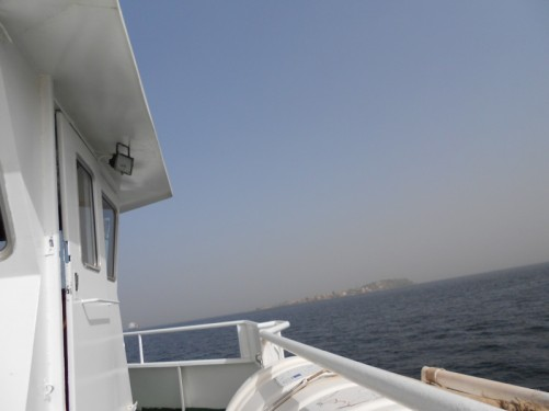 View from the deck of the boat. Heading to Ile de Gorée, which is approaching in the distance.