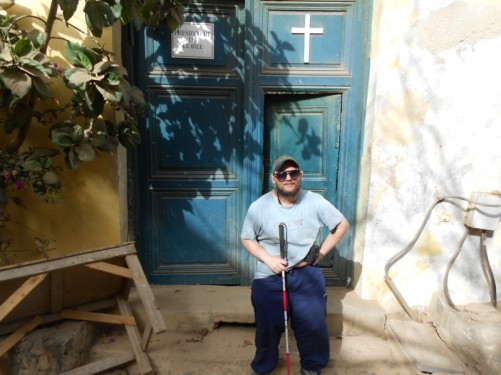 Tony outside the church: 'Presbytere de Gorée'.